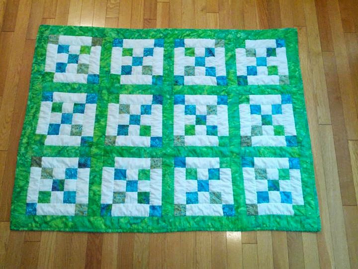 This quilt top was started by my Grandma Lou but she never finished it before she died. I finished to give as a present to my cousin's  baby boy. Machine Quilted. Finished in November 2013
