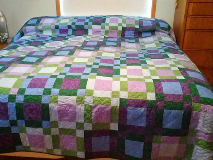 King size uneven nine patch quilt for my parents bedroom.