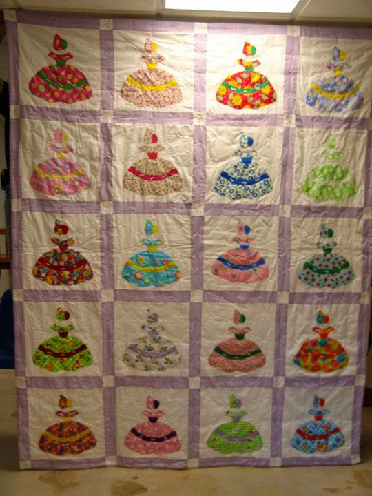 Southern Belle Quilt. I made this one off a quilt made by my great-grandmother in the 70's It's completely different colors but I traced the design off her quilt. My first attempt at applique - and it wasn't a very good attempt.