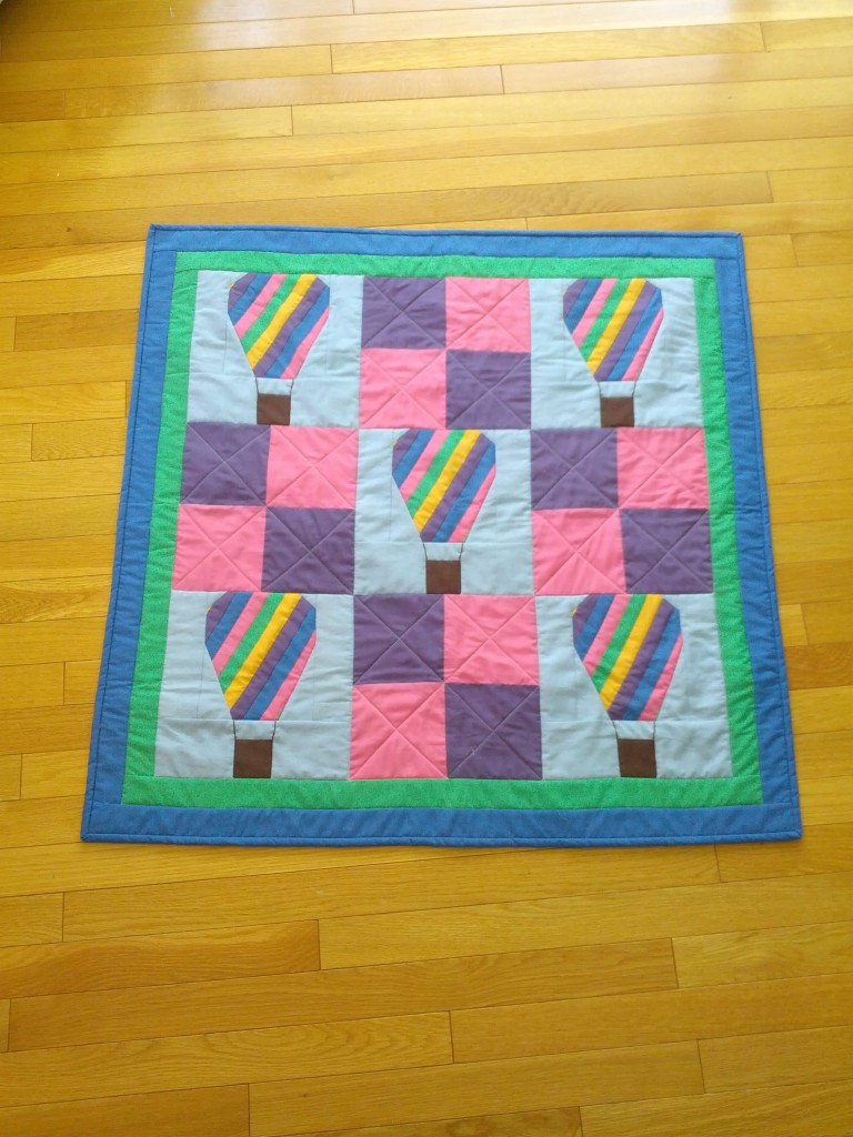 The finished quilt. Machine Quilted on my embroidery machine. Quilt Completely on